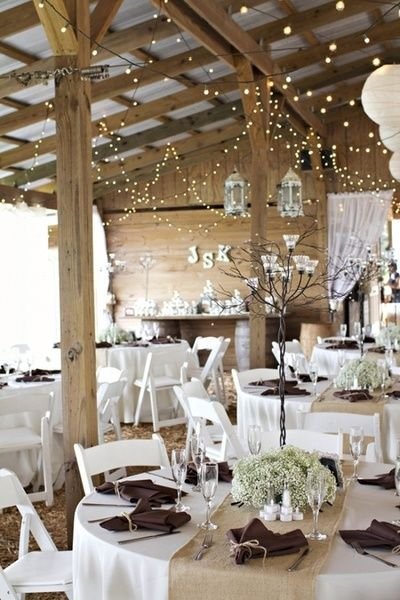 I like the lights and the baby's breath table settings, very simple and understated yet beautiful