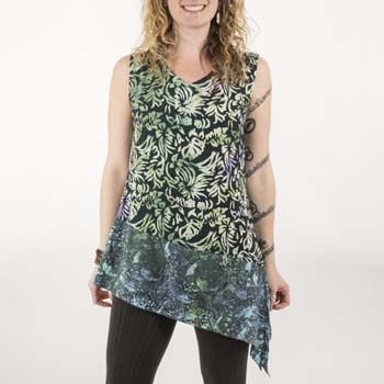 The unique Baru Angle tunic top boasts a bold asymmetrical hemline and a chic color-blocked patchwork of bohemian batik!   The hand-batiked rayon fabric is cool and comfortable and looks equally great paired with stretchy leggings, jeans, or skirts. Bring a burst of exotic color and entrancing pattern to your style with this sophisticated tunic top!