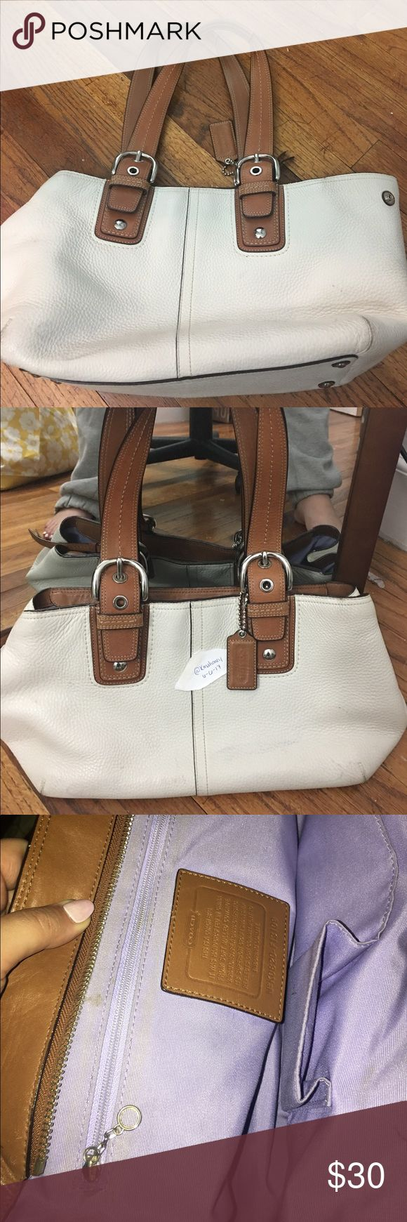 Coach Leather Cream Shoulder Bag Used COACH Leather Shoulder Bag with cream colored exterior, light brown handles and lilac interior.   This bag has been well loved but still have much life left within her.  The exterior has a few scuffs and a little color transfer from jeans.  I haven't tried to clean in depth- but I'm sure a little elbow grease will work.  Lilac interior has a few small stains and pen marking- but again- can be brought back with some TLC.  Great bag- zips close and has a…