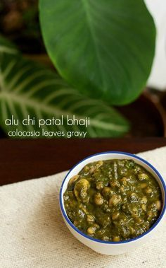 colocasia leaves gravy recipe with step by step photos. tangy and sweet bhaji made with colocasia leaves also called as alu chi patal bhaji. alu is the marathi word for colocasia leaves or arbi ke patte.