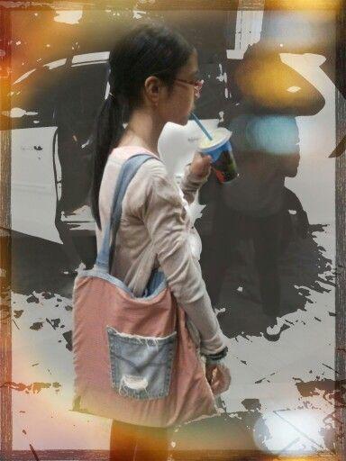 Tote bag with denim pocket.