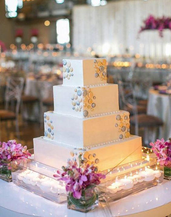 Glamorous four tier square shape white wedding cake; Featured Photographer: Untamed Heart Photography