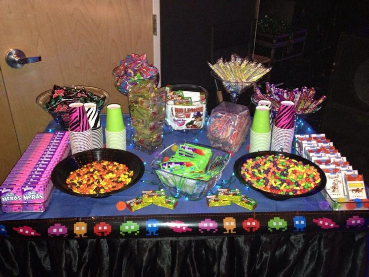 80's candy bar. Nerds, Reese's Pieces, Fruit Stripe Gum, Runts, candy cigarettes, Pop Rocks, Gummy Bears, Big League Chew, Pixie Stix, Spree, SweeTarts, Ring Pops, Fun Dip, Candy necklaces.