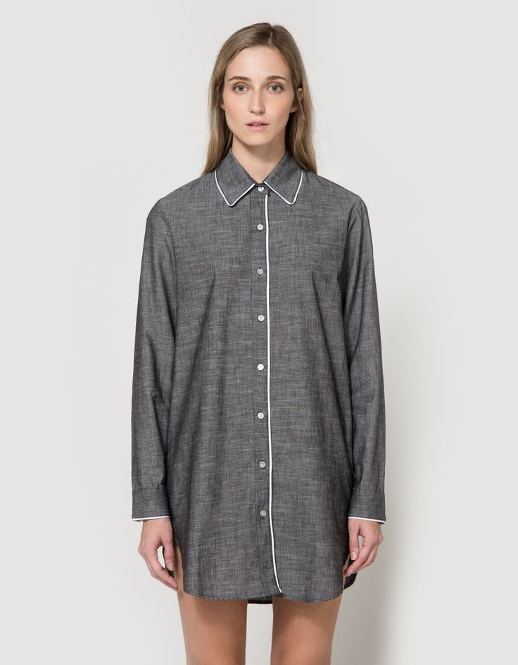 Sophisticated sleep shirt-dress From Maison Du Soir in Black. Pointed collar. Full-button placket. Left chest pocket. Single button barrel cuff.  On-seam side pockets. White piping accents. Shirt hem. Casual fit.  • Chambray • 100% cotton • Machine wa