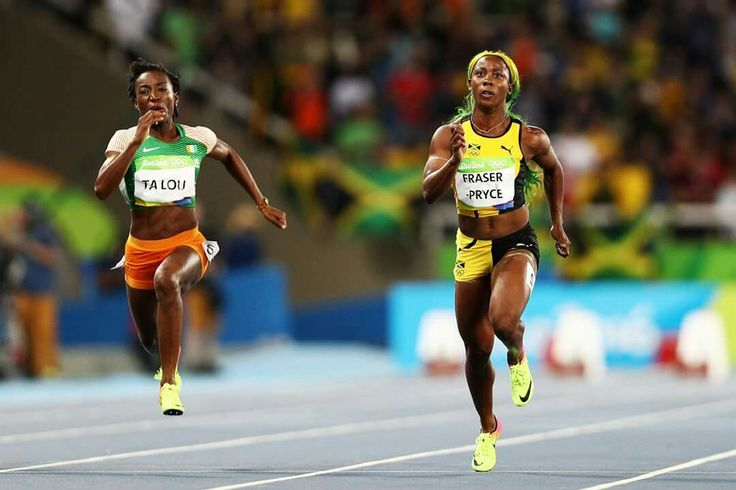 RIO DE JANEIRO, BRAZIL - AUGUST 13: Shelly-Ann Fraser-Pryce (R) of Jamaica and Marie-Josee Ta Lou of the Ivory Coast compete in the Women's 100m Semi final on Day 8 of the Rio 2016 Olympic Games at the Olympic Stadium on August 13, 2016 in Rio de Janeiro, Brazil. (Photo by Paul Gilham/Getty Images) — in Rio de Janeiro, Brazil.