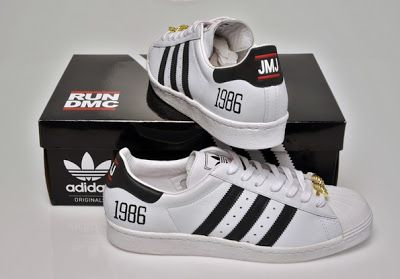 Limited Edition Run DMC Adidas Sneakers with a gold dookie.