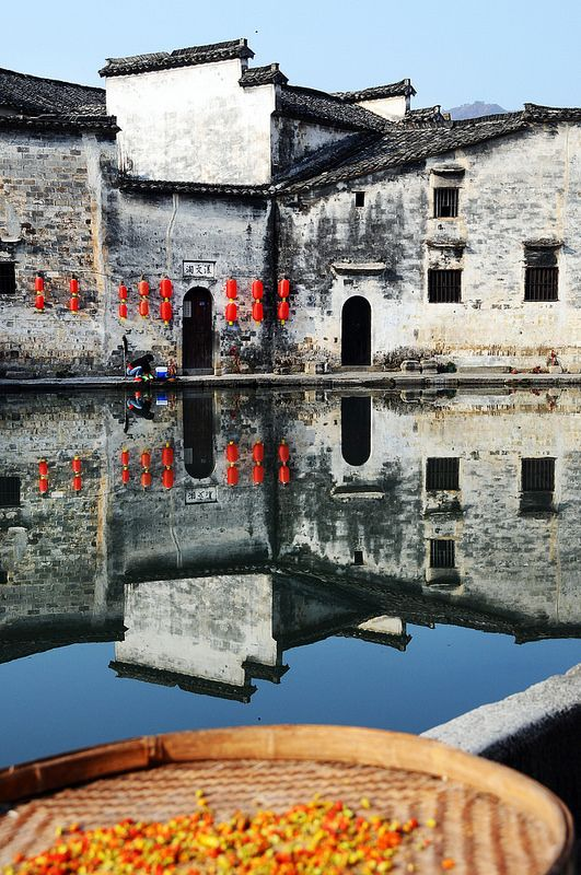 """Hongcun (Chinese: 宏村; pinyin: Hóngcūn, lit. """"Hong village"""") is a village in Yi County in the historical Huizhou region of southern Anhui Province, China, near the southwest slope of Mount Huangshan. Together with Xidi, the village became a UNESCO World Heritage Site in 2000. Scenes from the film Crouching Tiger, Hidden Dragon were filmed on location in Hongcun."""