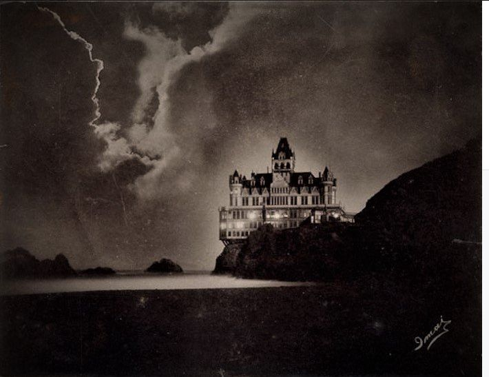 San Francisco's improbable Cliff House Hotel. Built 1896, survived 1906 earthquake, burned down 1907. Photo by Japanese photographer Imai.