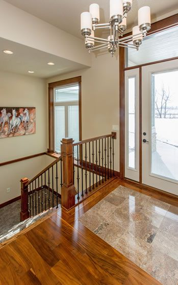 "Tuck staircase to basement by front door. Use an open concept, including a ""turn with landing"" design to save space in basement. Transitional Ranch #5 Photos 