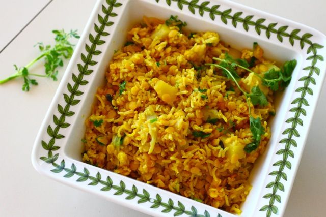 A protein packed South Indian lentil dish with rice, potatoes, onions, and fresh cilantro. A flavorful and colorful summer dish.
