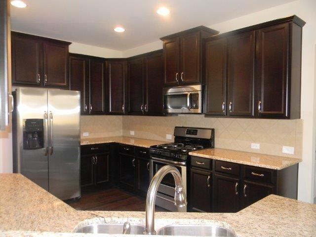 The arlington kitchen timberlake tahoe maple espresso cabinets giallo ornamental granite - Espresso cupboards ...