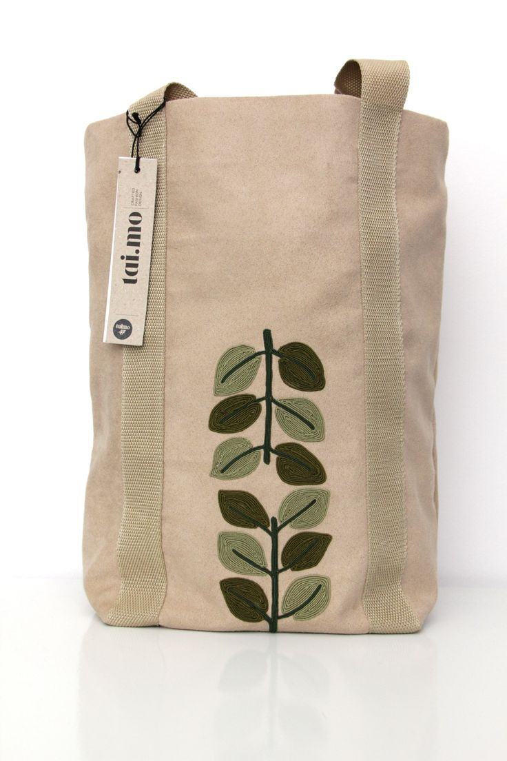 beige alcadara tote bag with green embroidered leaves by #taimo