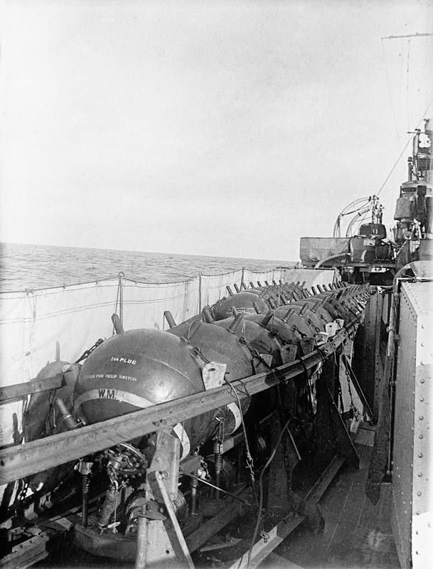 """WWI: Horned contact mines on HMS Aurora. Legends on mine are """"1in Plug"""" and """"Fitted for deep switch"""" -©IWM"""