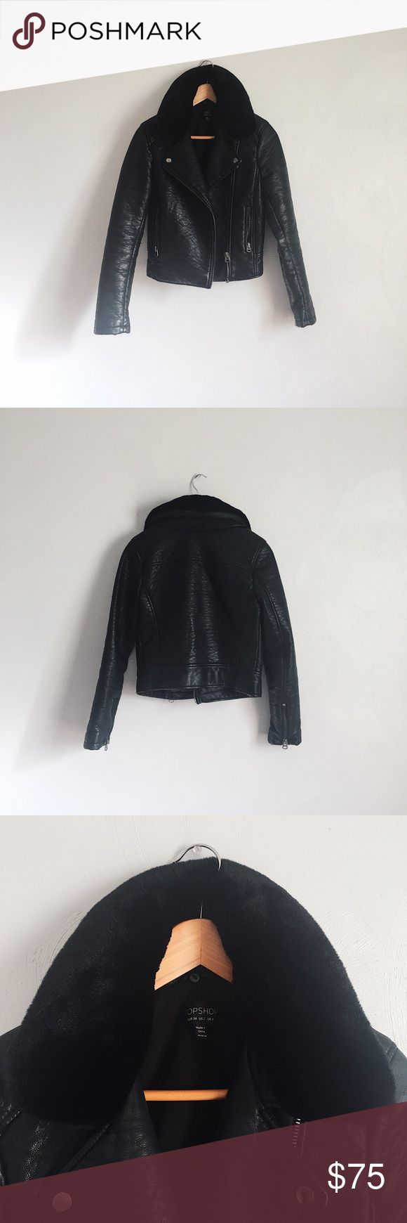 Topshop faux leather biker jacket with fur collar Only worn few times- great condition! Marked as US size 2, UK 6, EUR 34. Fits like an XS/S. Really nice thick material. Jacket and fur collar are both faux. The fur collar is removable so it's a great transition piece between warmer and cooler seasons. The last photo shows the jacket without the collar. Topshop Jackets & Coats