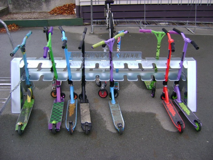 Scooter Racks. For a school who was getting fed up with students dropping scooters all over the place. Designed and Fabricated by Red1 Fabrication.