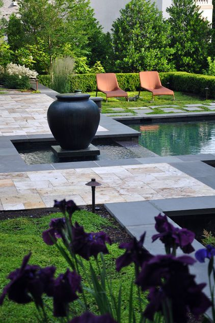 A regular pattern carries all the way through this garden scheme with the use of differing heights, materials and textures, all with basic 90-degree geometric shapes.