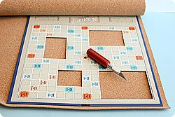 Scrabble picture frame. Glue some letters on there, throw some pictures. Voila.