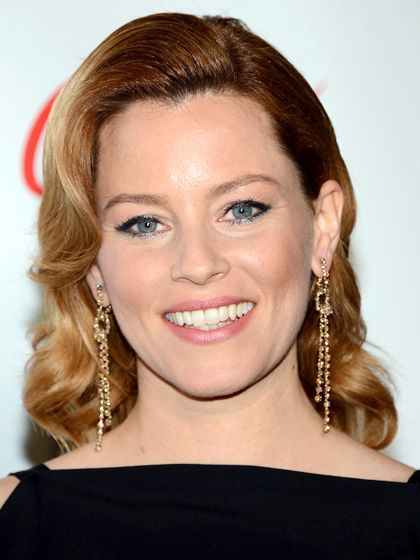 ELIZABETH BANKS Older: Barrel curls and a forehead flip make Banks's hair look so stiff and sculpted you could easily imagine it on a bust in a museum.