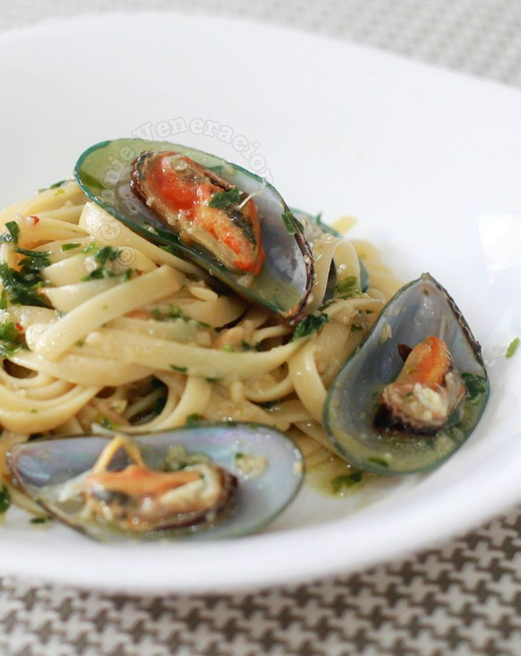 Pasta was boiled in leftover mussel broth then cooked as fettuccine aglio e olio with mussels on the half shell thrown in.