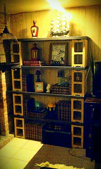 Just finished this shelving unit. Mettalic Gold spray painted cinder blocks and 2x12x4.5 painted black cedar!
