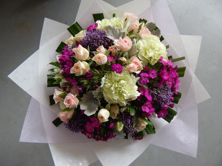 Spray roses, sweet william, dusty miller and carnations
