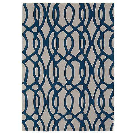 The 'Wire' range of rugs feature a contemporary swirling pattern in bold, contrasting colours. This blue and grey version is hand-tufted in wool and available in 3 different sizes.