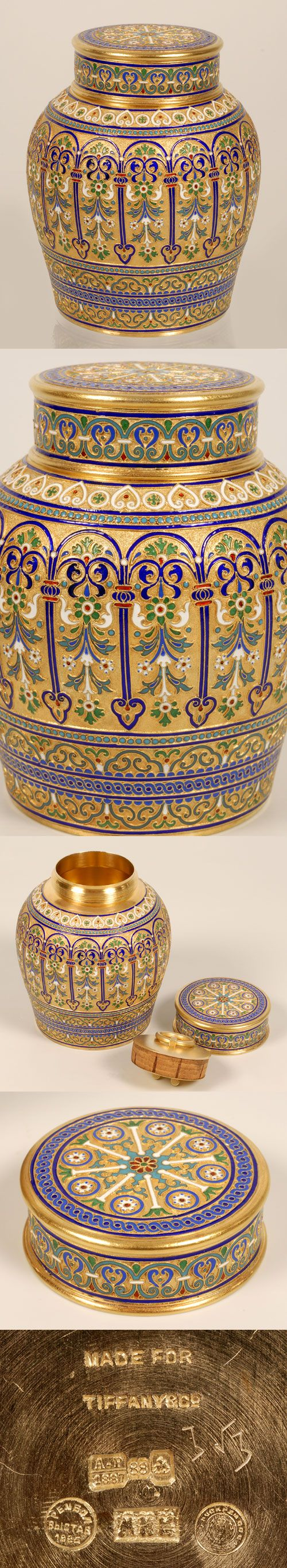 A Russian silver gilt and cloisonne enamel tea caddy, Moscow, circa 1887. The barrel shape caddy enameled in an overall multi-color scrolling foliate motif between stylized cobalt blue enamel columned arches against a gilded stippled ground