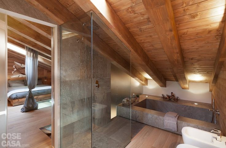 attic bathroom with natural wood chalet style