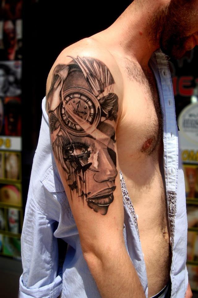 Great upper arm face, clock and butterflies tattoo