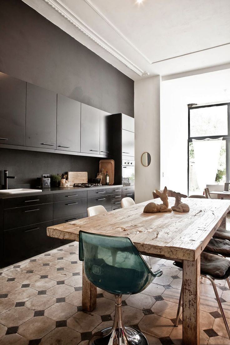 This Dining Room/kitchen Design Is A Delicious Mix Of Rustic U0026 Minimalist.  Sleek Black Cabinets Are Combined W/ An Aged Wooden Dining Table U0026  Mismatched ...