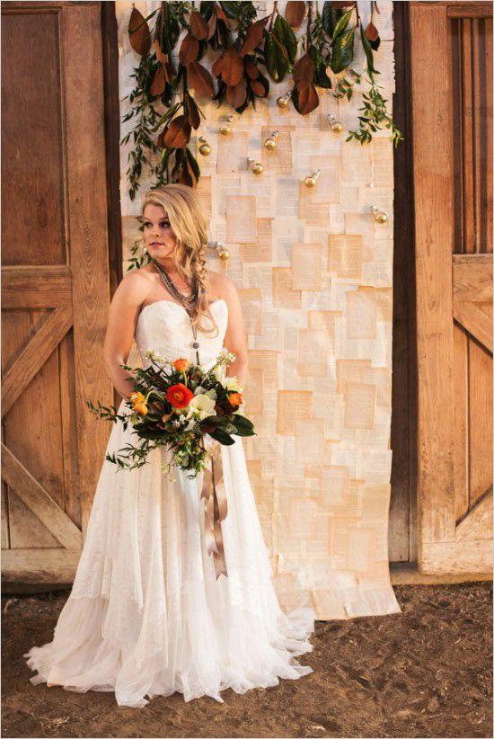 Antique book page ceremony backdrop. #weddingchicks Captured By: Lightbox Photography http://www.weddingchicks.com/2014/06/20/funky-braided-wedding/