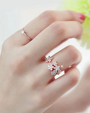 Rhinestone flowers ring - the gap makes a wide ring seem quite delicate.