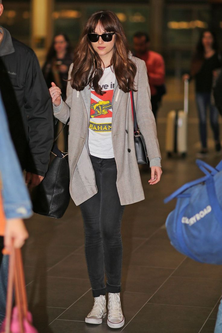 Dakota Johnson leaving Vancouver last night. Is she going to the MTV Movie Awards? We don't know. Only time will tell. By the way don't miss the Awards tomorrow April 10th at 8:00pm and find out if Ana & Christian win the Best Kiss.    Pics Credit: FiftyShadesEn