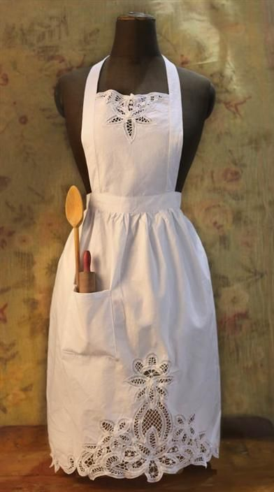 A lace pattern supposedly invented in the latter 1800s by Queen Victoria's daughter, Beatrice Battenburg, adorns this white cotton apron.