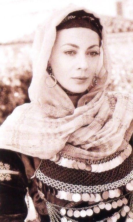 Greek actress, Smaragda Karydi, posing for photographer Kalliopi in a traditional costume