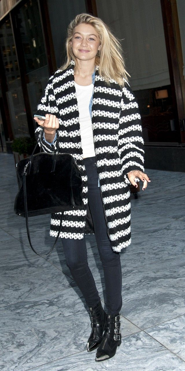 Gigi Hadid's foolproof cold weather look: striped cardigan, skinny jeans, and buckled ankle boots.