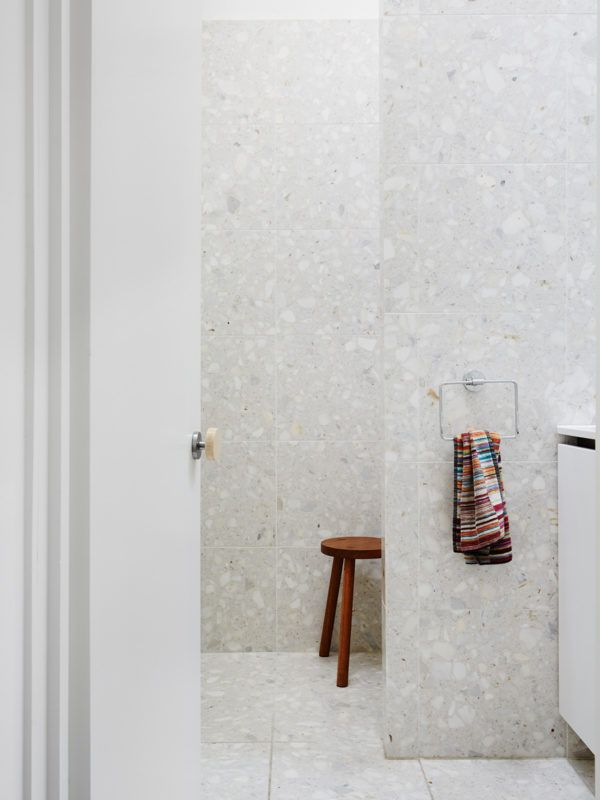 Bathroom detail. Door handle is bamboo and made custom by Foomann Architects, stool is Milca by Arteveneta.