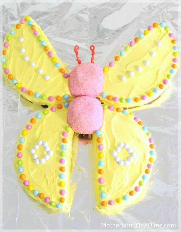 Butterfly cake! Just two round cakes, cut and arranged.  Decorate with sixlets or Skittles, two Sno-balls make the body, licorice wrapped around toothpicks for antennae.  I want to use three cupcakes in the middle and frost them to make honeybee!