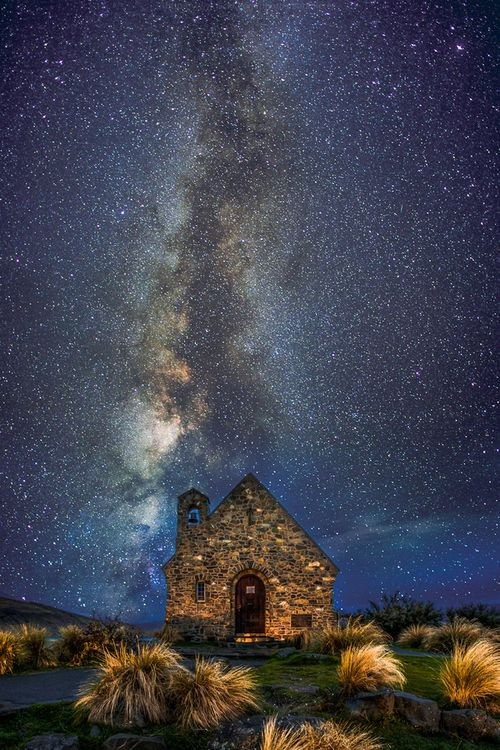 Milky way over stone cottage