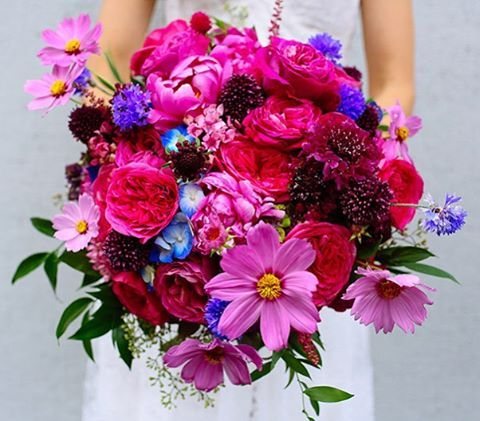 Today we are sharing our favorite #bouquets from 2015 over #onGWS - this bright #pink #weddingbouquet by @thebloomoftime was a personal fave and would be great inspiration for other brides looking for a bold + bright bouquet // photo: @jessechamberlin for @ourlaboroflove -{direct link in profile to see all our other picks} #weddingideas #katespadewedding #GWSweddingartist
