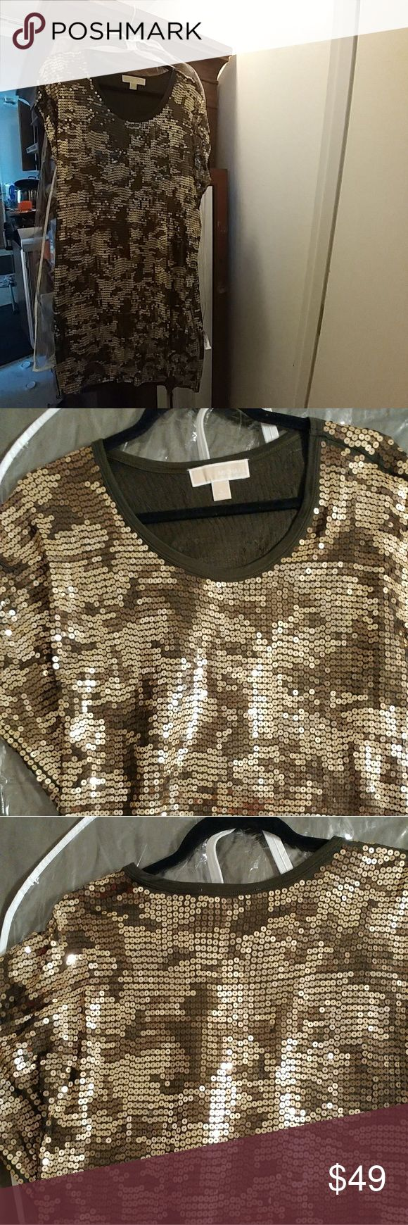 Worn 1 x MICHAEL KORS t shirts style sequin dress Gorgeous  classic style.Olive green dress with golden,chocolate,and silvery sequins that layflat on the fabric so it's not heat,or as dressy.It can be worn as a tunic with leggings,or as a sheath dressSize S-L can wear it depending on how you wAnt to wear it..belted or loose ..its a stunner! I will include the new $5 storage bag. MICHAEL Michael Kors Dresses Midi