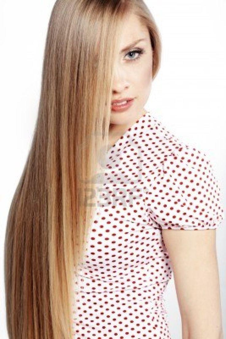 Ritratto di giovane donna bella con lunghi capelli biondi lucidi Archivio Fotografico