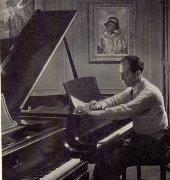 George Gershwin composing at the piano, uncredited photo