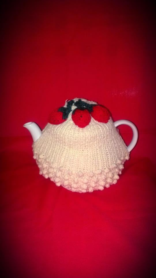 Home made knitted Strawberries and Cream Tea Cosy. Visit http://www.facebook.com/KittyAndTiz to find out how to buy