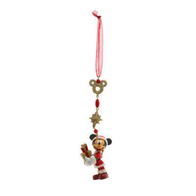 Glittrig julstatyett med Musse Pigg som kommer med presenter. Den har en ögla i chiffong för upphängning.