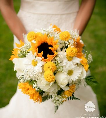 Sunflower wedding bouquet with craspedia, daisy mums, baby's breath and roses.