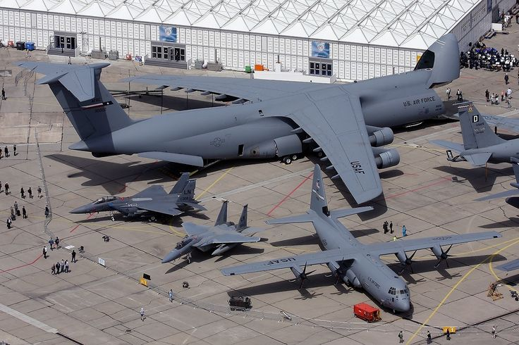 The C-5 Galaxy next to a C-130 Hercules and a couple of fighters.