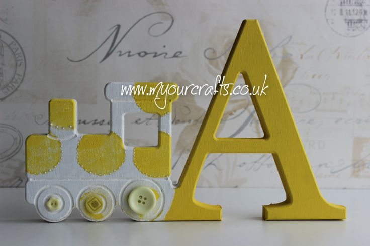 Wooden crafts. Bespoke mdf freestanding letter with train shape attached. Nursery or baby rooms decor. A keepsake gift for baby girl or boy. Available at www.myourcrafts.co.uk