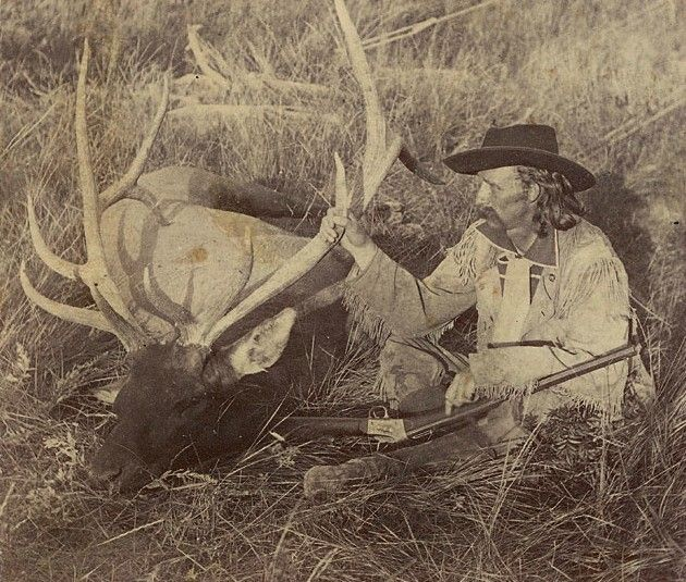 General George Armstrong Custer beside an elk that he shot, South Dakota Black Hills, 1874
