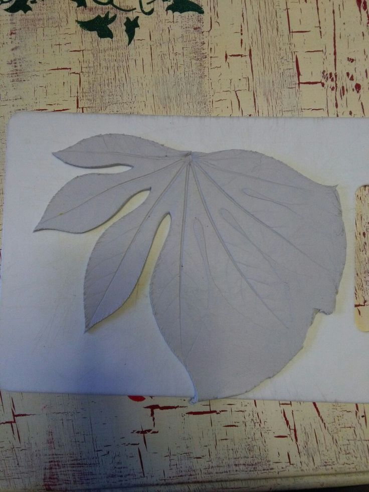 Peel of leaves and cut around shape.